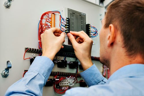 Electrician near the low voltage cabinet