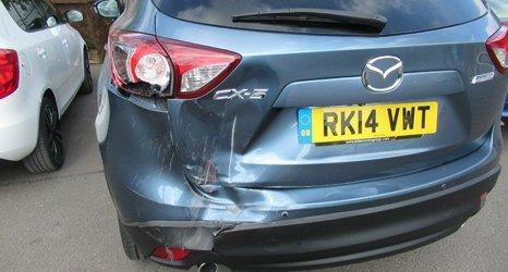 blue car damaged