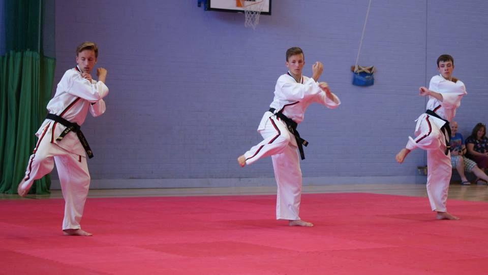 A boy practising martial arts