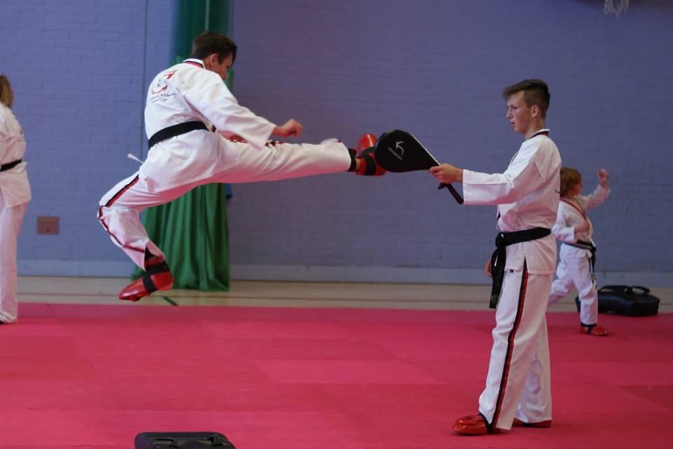 A boy doing air kick