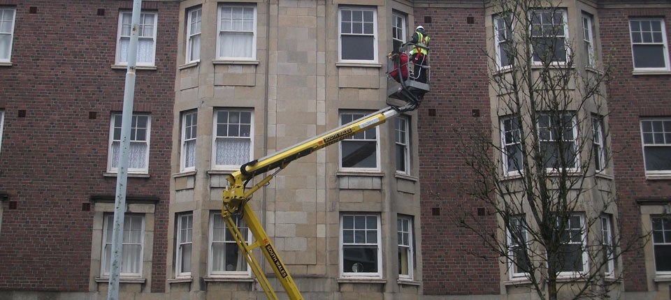 A cherry picker being used for window cleaning