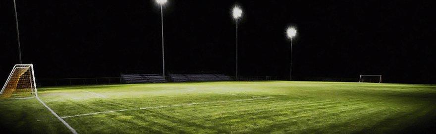 An empty, floodlit football pitch