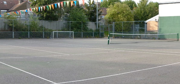 Coloured bunting over a tennis court