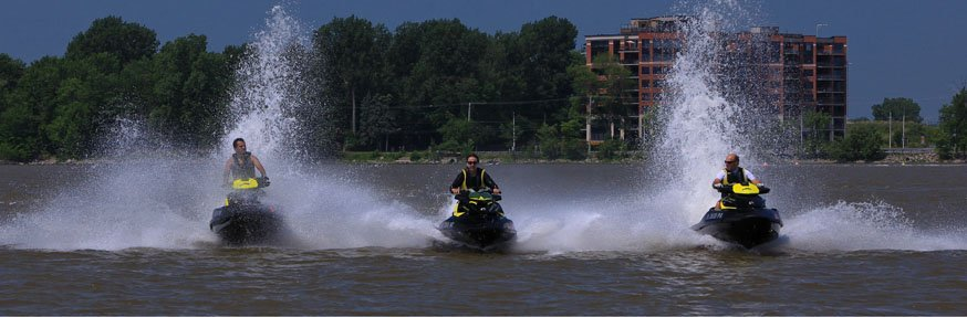 Group of professional riding a jet ski