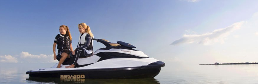 Women wearing a protective gear sitting on the jetski