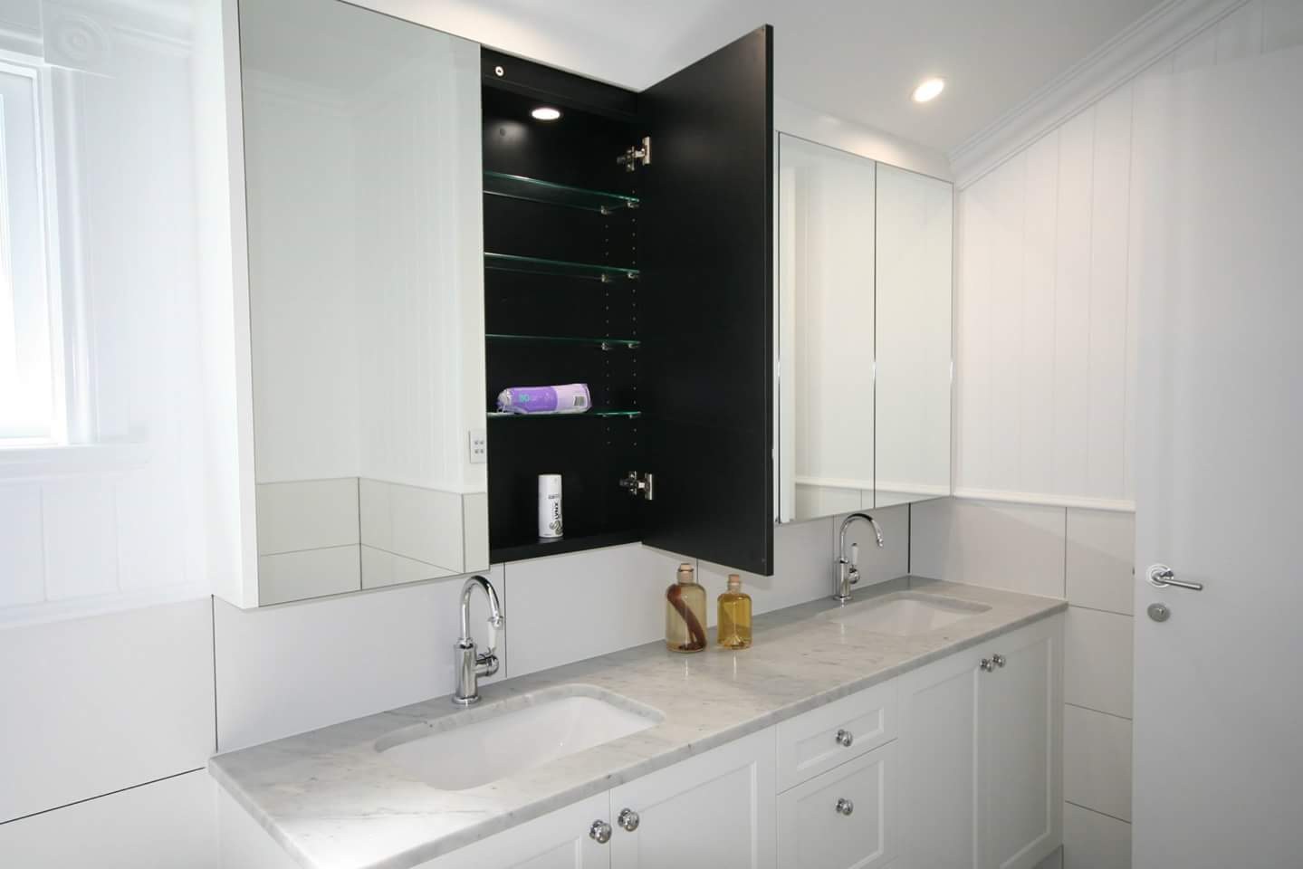 white bathroom cabinets with light countertops