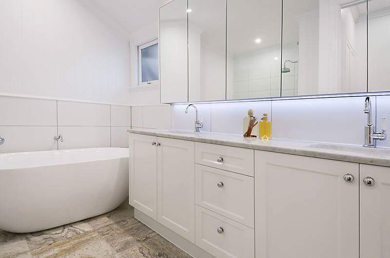 white bathroom with new cabinets