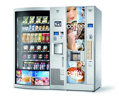Distributori automatico con scritta coffee e cafè