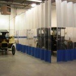 1914 Ford Model T Runabout and a 1913 Pierce Arrow Sedan in our finishing area