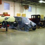 1906 Cadillac along side the 1928 Chevrolet and 1933 Plymouth Race Car