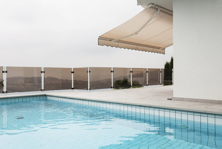 Awning and swimming pool