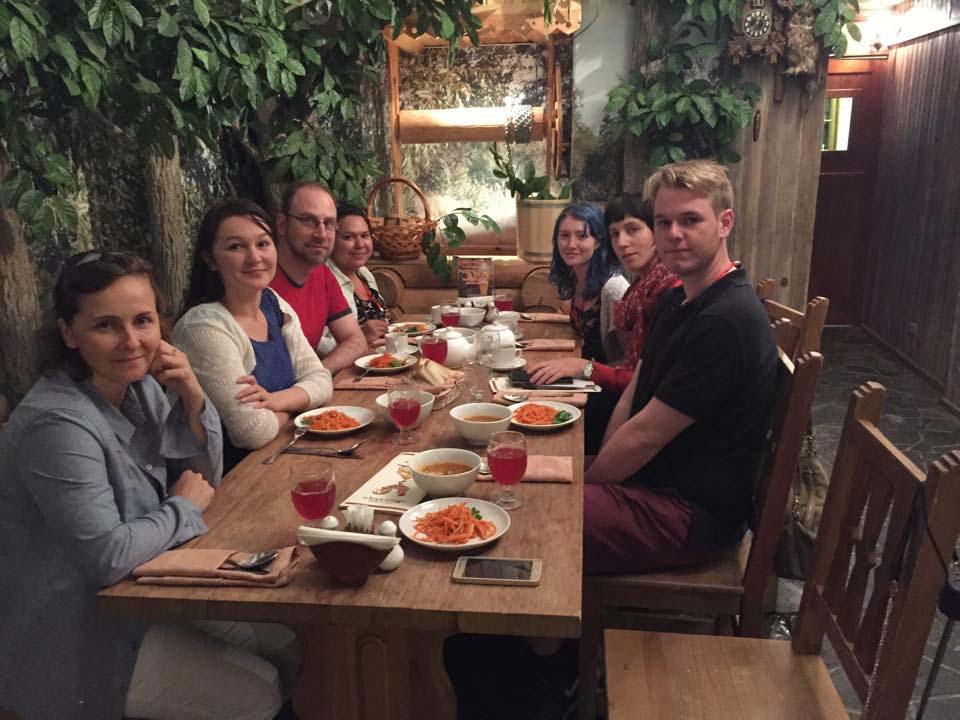 Tourists enjoying meals during Russian tour