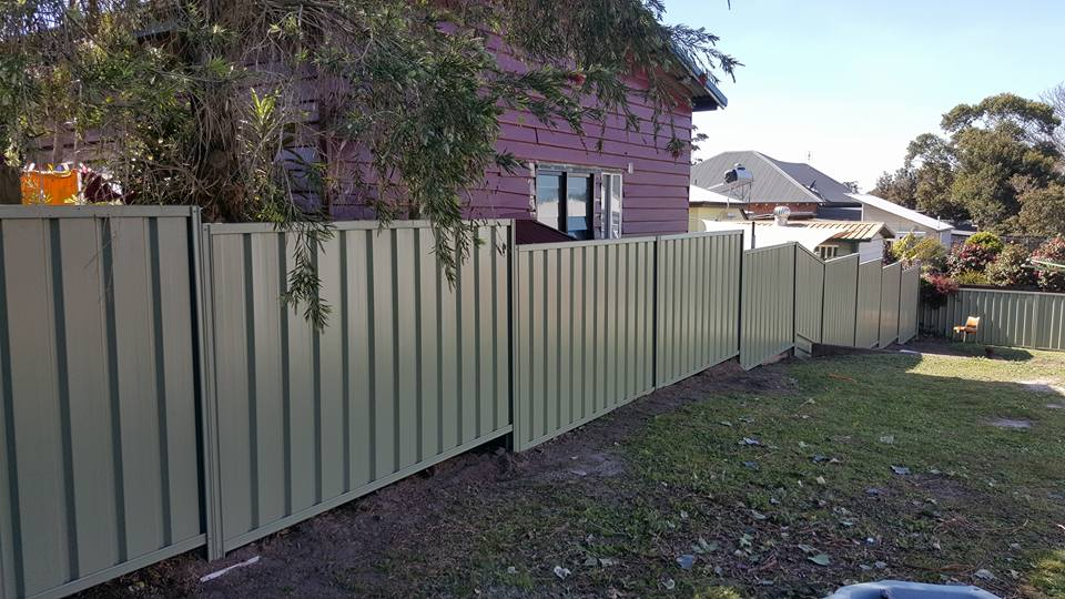staggered green color bond fence