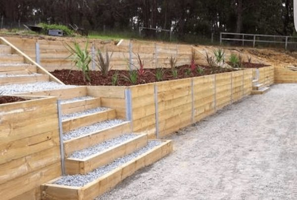 retaining walls with flower beds and stairs