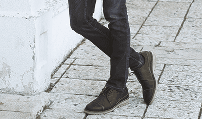 Man wearing custom inserts for leather footwear