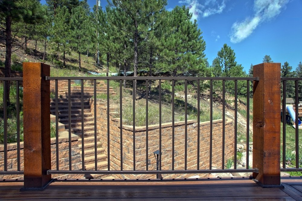 View of the railing pillars made from treated wood in Denver