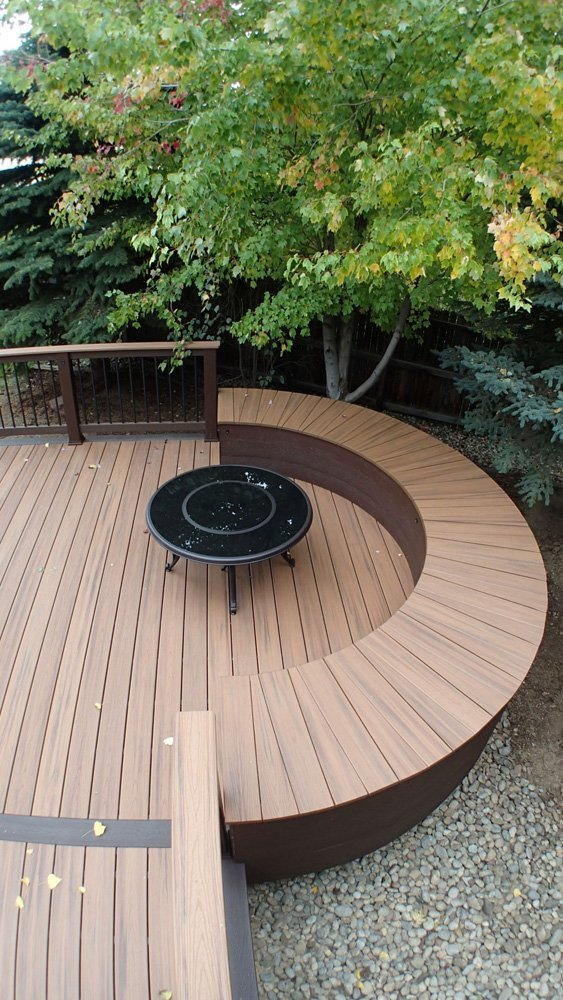 View of the deck with custom radius bench around fire pit area in Denver, CO