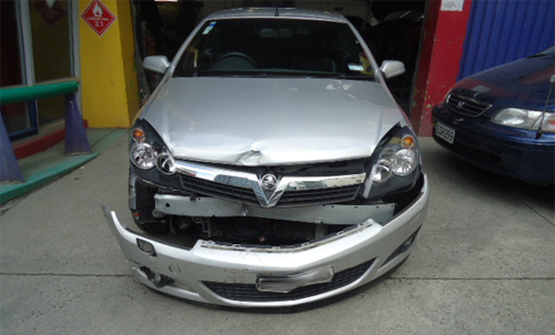 Crashed automobile for repair in Wellington, NZ
