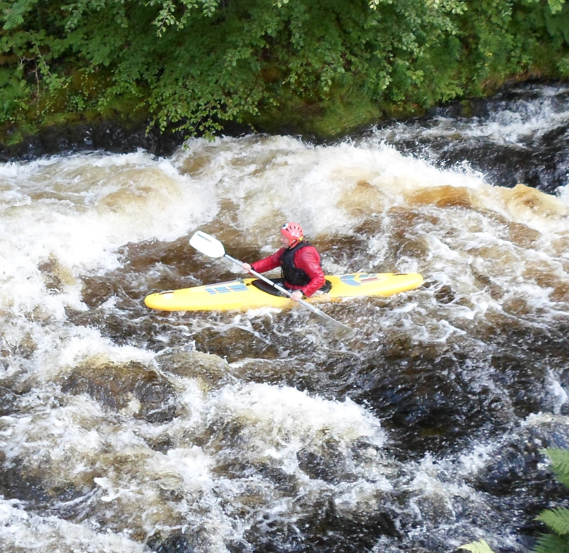Whitewater kayaking on the river