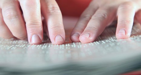 Hand upon braille book