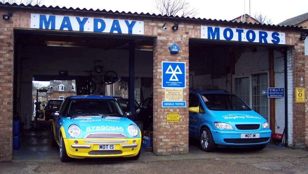 mayday motors garage with two cars parked