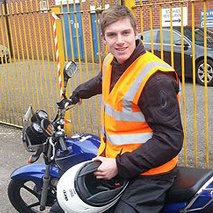 biker wearing orange jacket