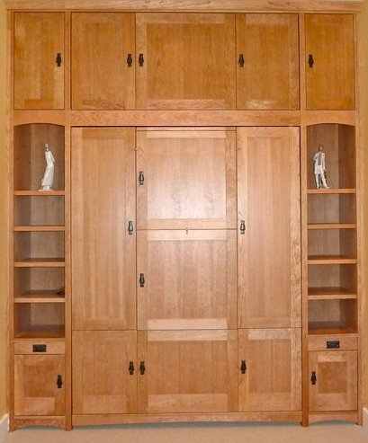 Custom Craftsman-style cherry wall bed with built-in bookcases and overhead storage