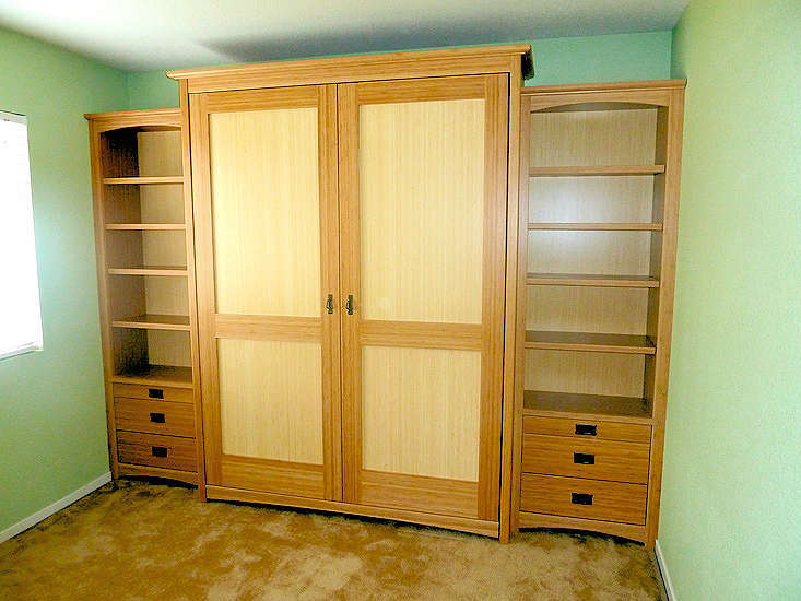 Made with both amber and blond bamboo. -- Craftsman-style bed, side units with pull-out night stands and drawers
