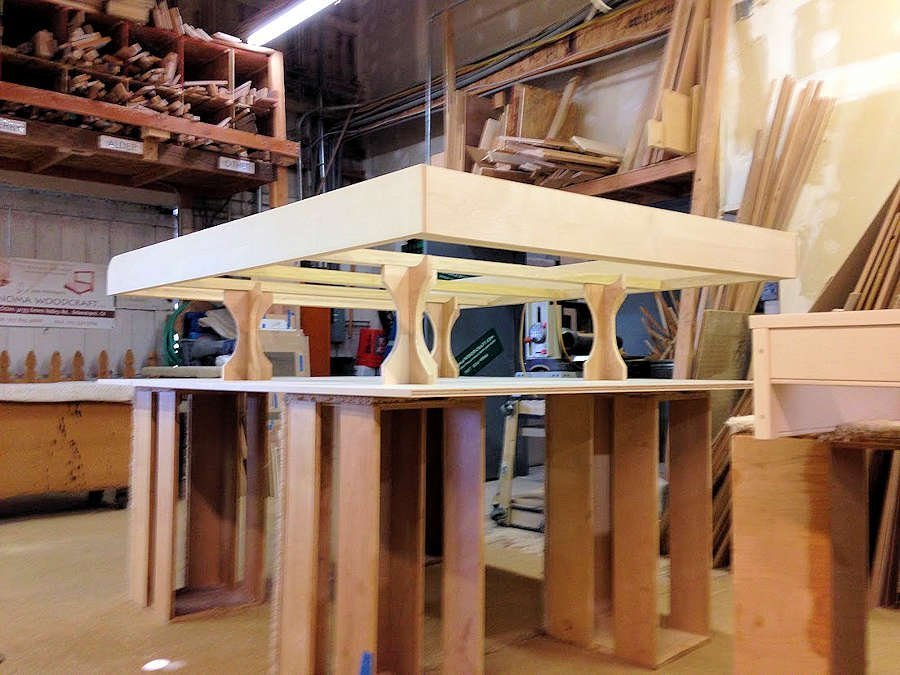 Inner bed frame poised for assembly to the bed face.