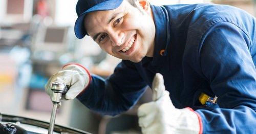 Professional repairing a car