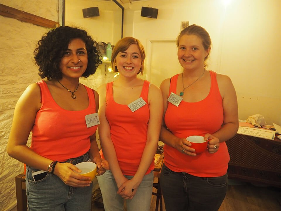 three women in red shirts at a party