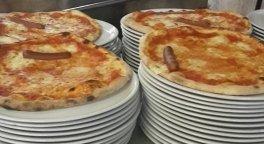 pizze appena uscite dal forno