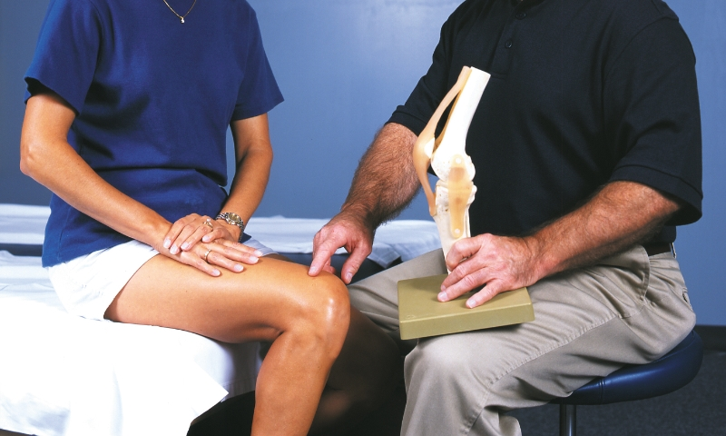 Physical therapist explaining knee joint