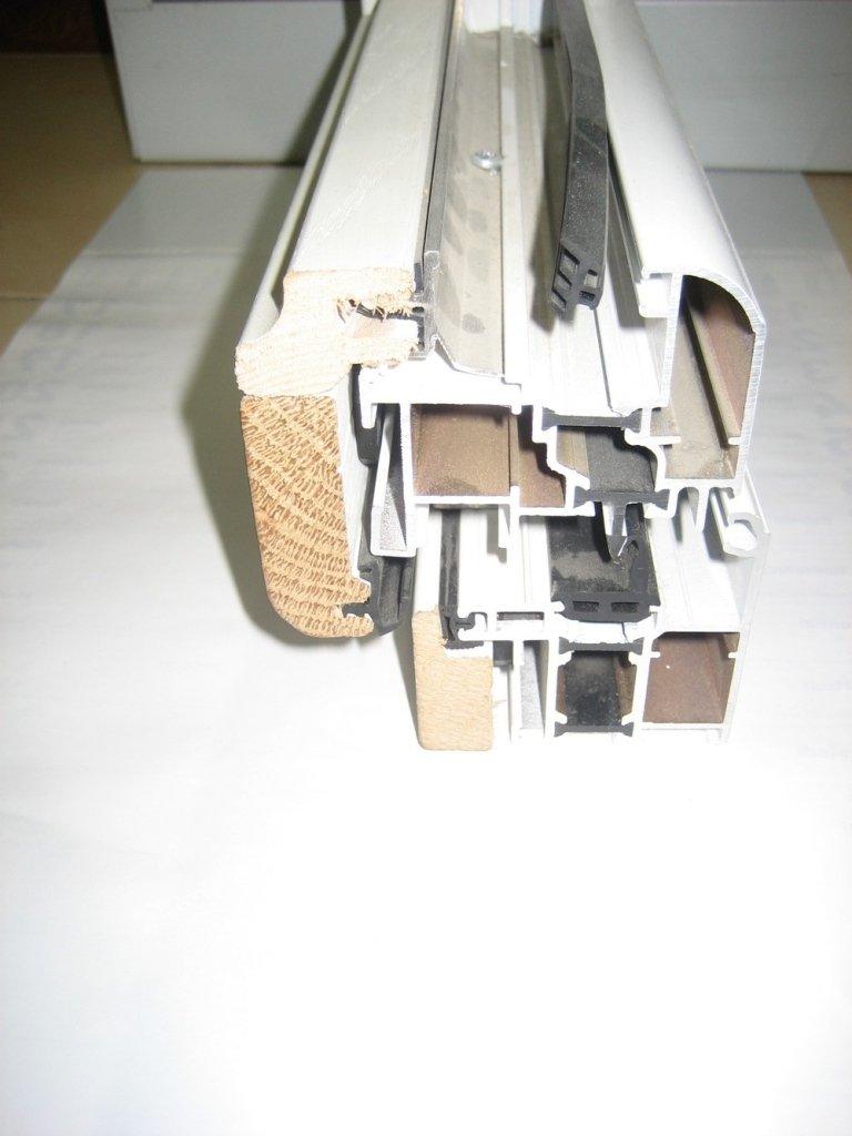 sezione taglio finestra alluminio legno