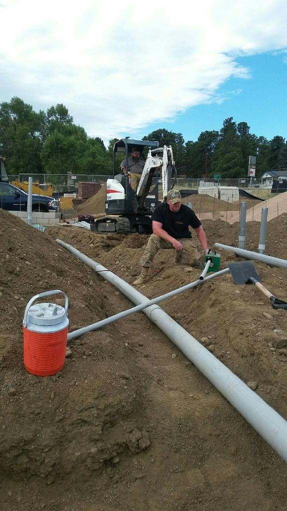 Laying down the foundation for electrical wires in Littleton, CO