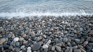 waves breaking on a stoney beach
