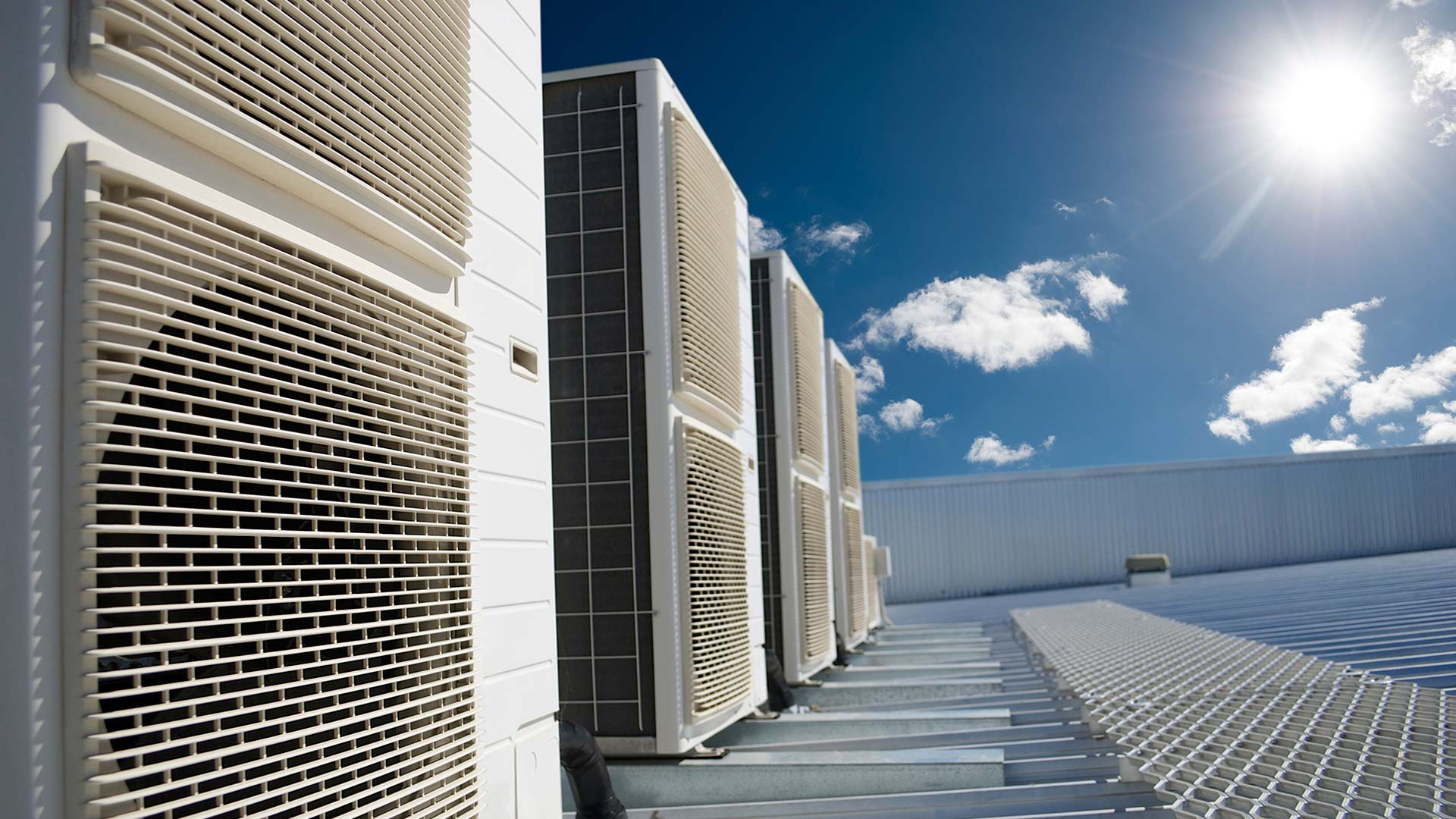 Commercial ac units on rooftop under blue sky