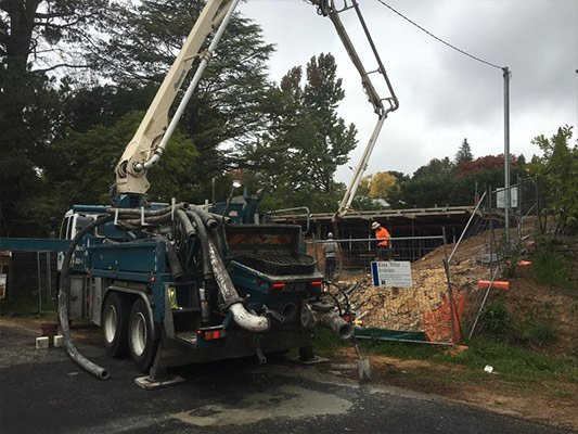 S & L Concrete truck pouring cement on worksite