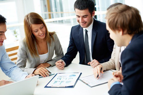 group of consultants reviewing seo results
