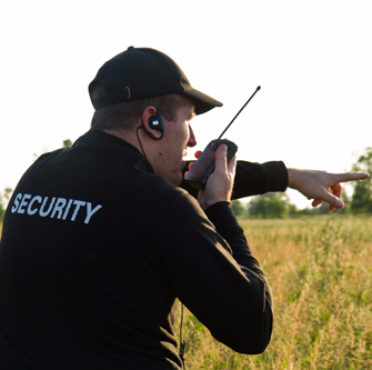 Security professional in action using a walkie talkie