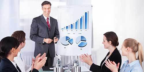 man finishing a presentation