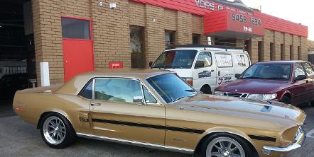 Cars parked outside the Vops automotive shop