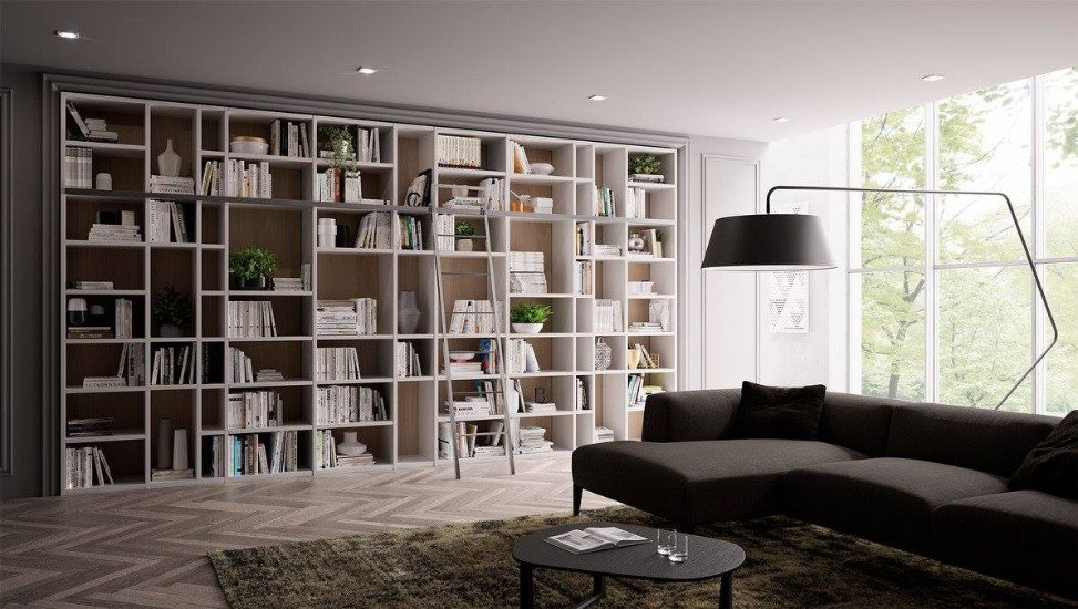 un libreria grande di color bianco e davanti un divano di color nero