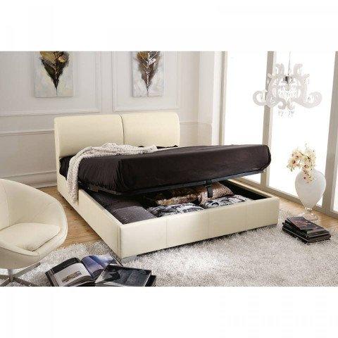 un letto con contenitore di color avorio
