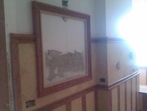 quadro appeso a un muro