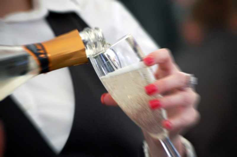 Customer being served sparkling wine
