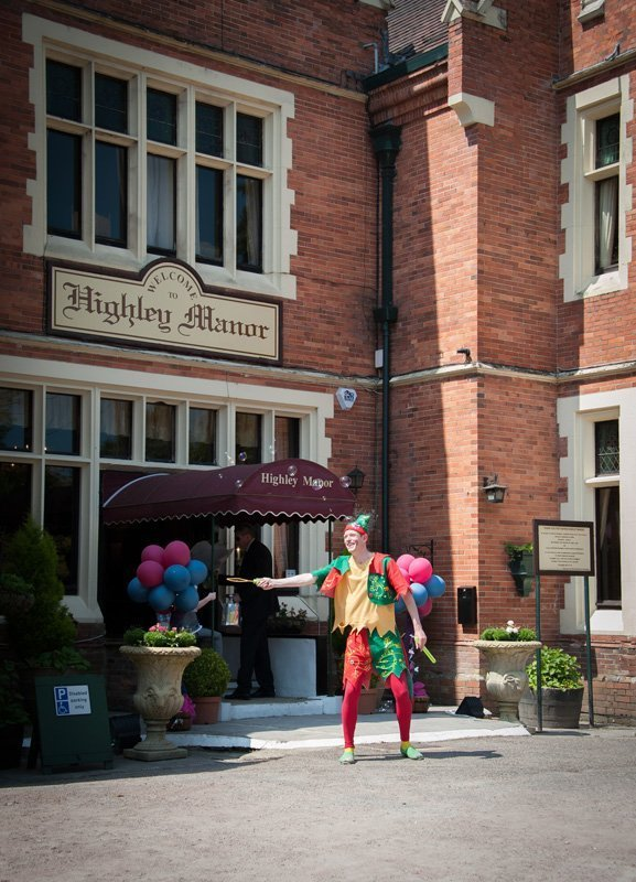 View of individual dressed as cartoon character in front of Highley Manor's entrance