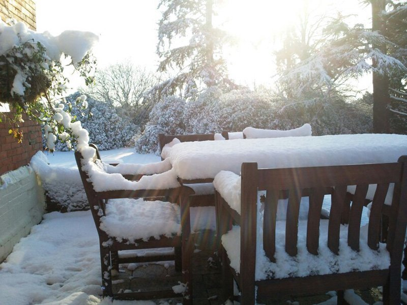 View of a snow covered seating of Highley Manor