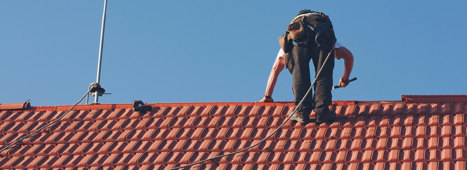 A roofer working on a roof
