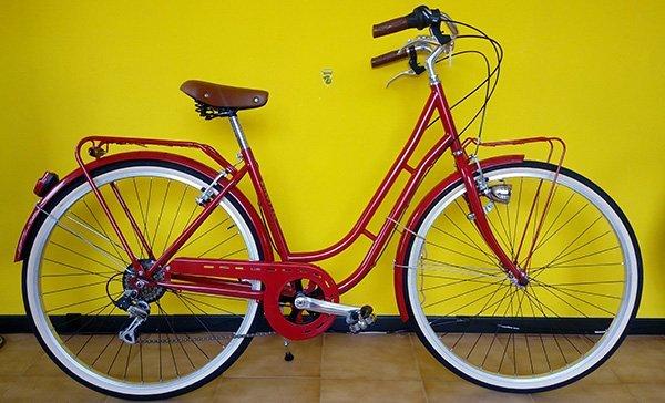 Bicicletta di doppia barra rossa per donna
